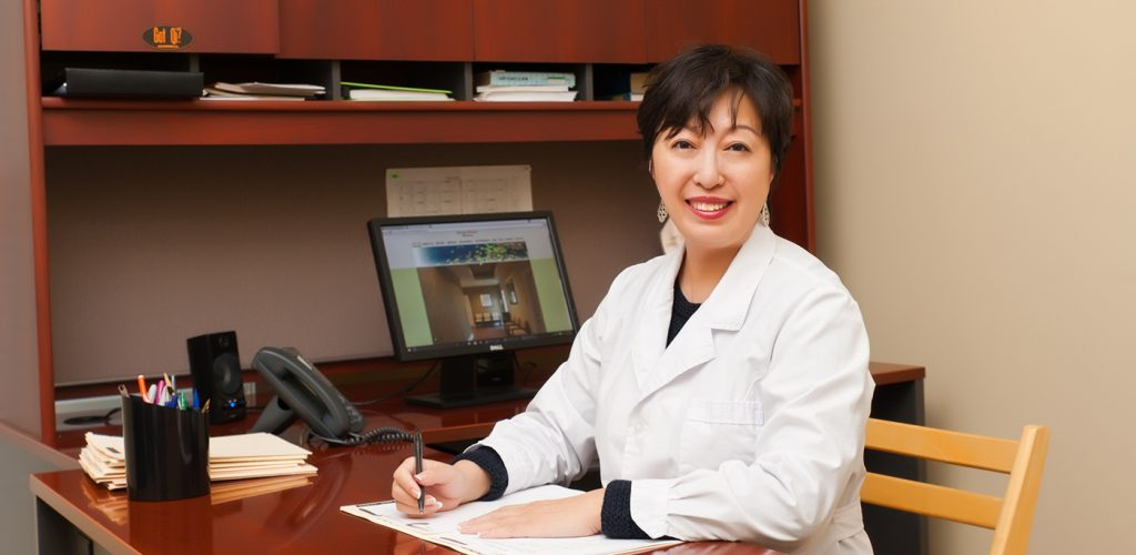 Dr. Jitao Bai in her Atlanta Acupuncture clinic Absolute Holistic Medicine